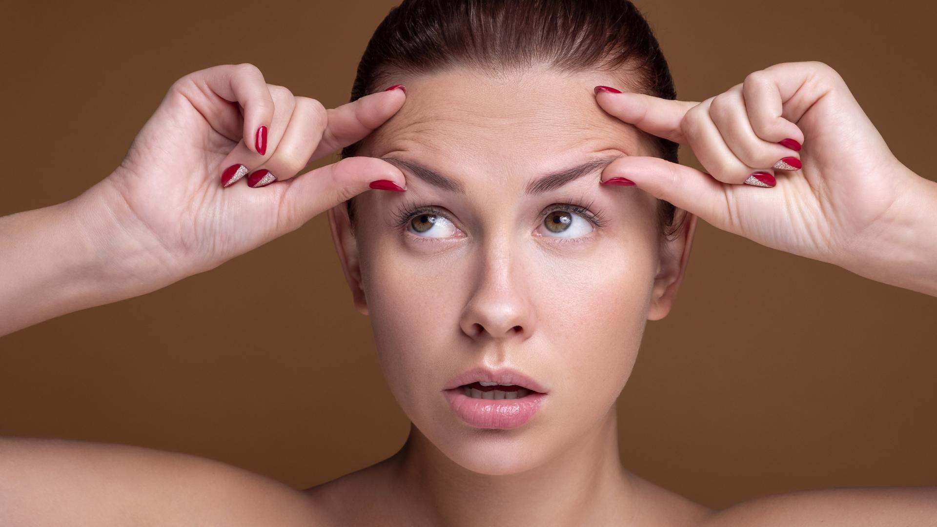 Чому з'являються зморшки на лобі